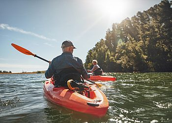 Two People Kayaking in the Sunlight