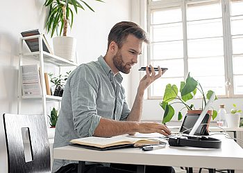 man on phone at desk