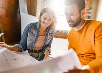 man and women looking at house plans
