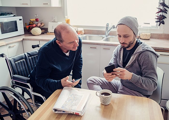 two men looking at phone