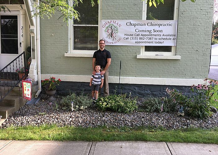 Father and Son Outside of a Chiropractic Practice