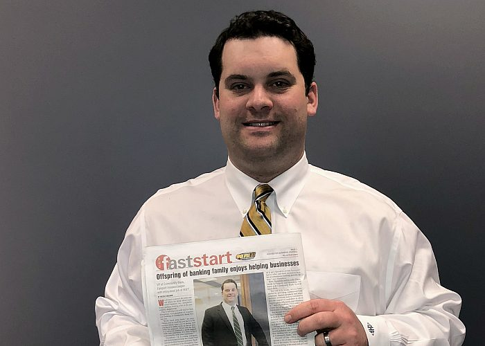 "Man Holding ""Fast Start"" Publication"
