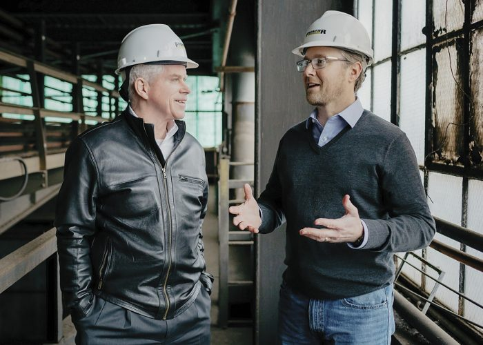 Two Men Talking at Construction Site