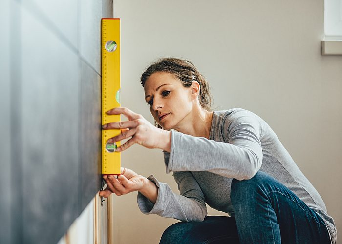 Woman Using Leveler