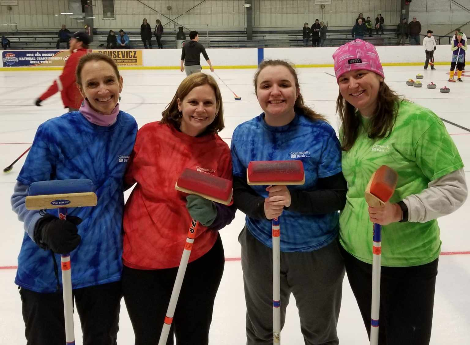 Women Standing With Curling Brooms