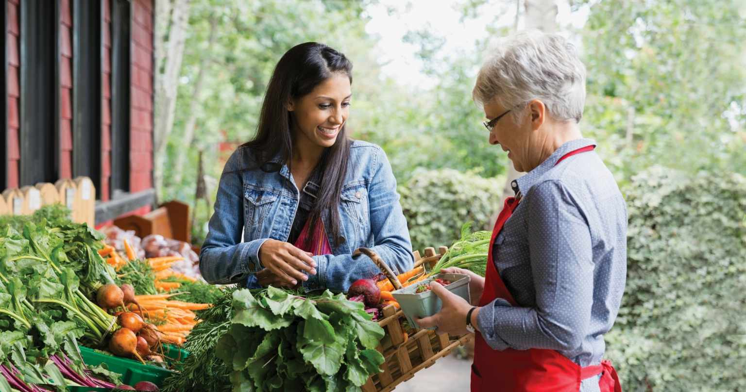 Women Talking at Vegetable Stand